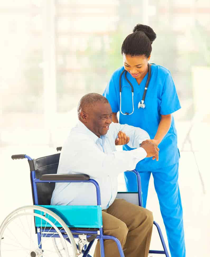 nurse assisting the senior man to stand up