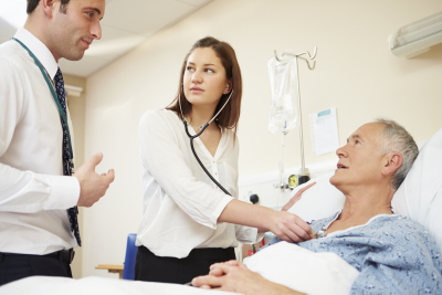 doctor and nurse consulting their patient